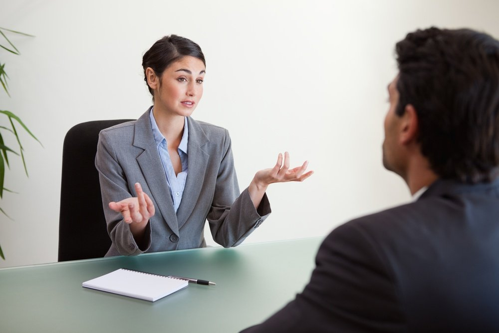 Manager interviewing an employee in her office